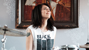 132795_16368_3_-_Kathleen_Hanna_playing_the_drums._Photo_courtesy_of_Allison_Michael_Orenstein